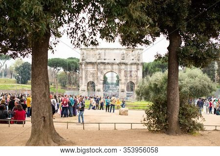 Rome. Italy - March 22, 2017: Arch of Constantine with Lots of Tousists in Rome. Italy.