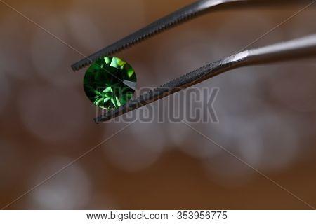 Close-up View Of Luxury Emerald Crystal Gemstone. Macro Shot Of Polished Green Diamond. Most Preciou