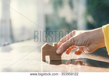 Real Estate Customer Hand Choose Home Models To Decide Purchase Decisions. Buyer And Seller Offers A