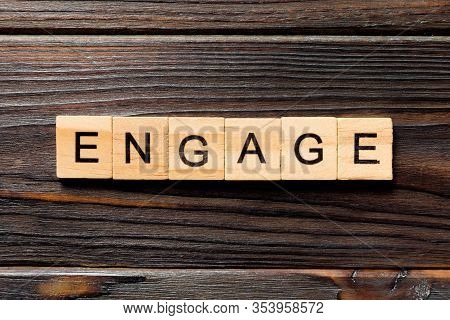 Engage Word Written On Wood Block. Engage Text On Wooden Table For Your Desing, Concept