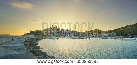 Talamone Village Skyline And Marina From The Pier At Sunset. Italian Travel Destination In Maremma.