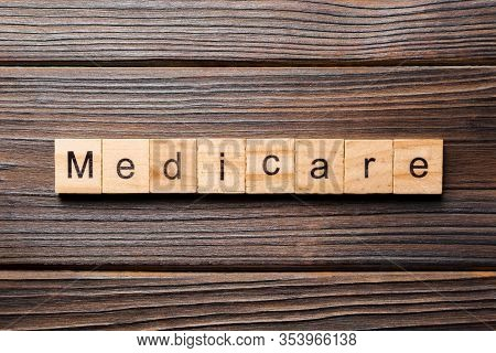 Medicare Word Written On Wood Block. Medicare Text On Table, Concept