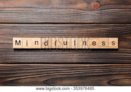 Mindfulness Word Written On Wood Block. Mindfulness Text On Table, Concept