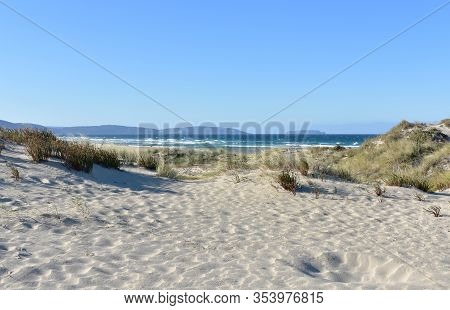 Summer Landscape With Beach, Sand Dunes And Wild Waves With Blue Sky. Arteixo, Coruña, Galicia, Spai