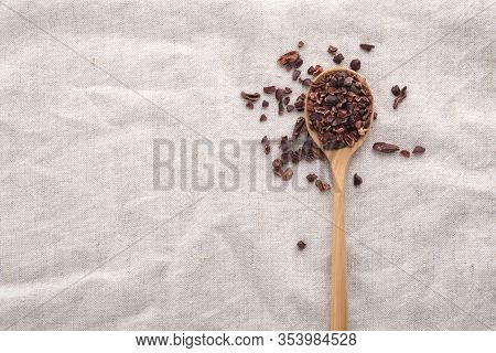 Cacao Nibs On Wooden Spoon