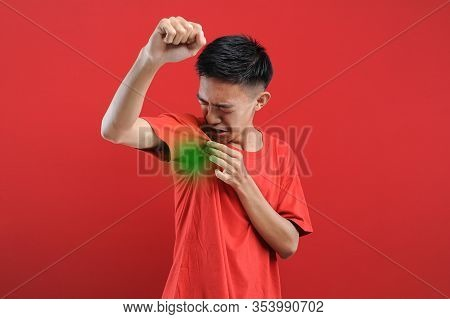 Asian Man With Hyperhidrosis Sweating Under Armpit, Feel Bad With Body, Odor Smell Problem, Isolate