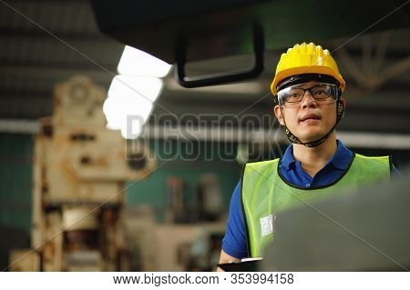 Professional Asian Worker. Engineers Are Saying Explained How To Control The Staff. The Engineering