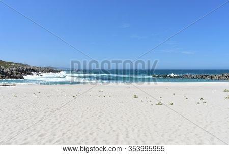 Summer Landscape With White Sand Beach And Wild Sea With Waves Breaking. A Marosa Beach, Burela, Lug