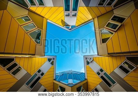 ROTTERDAM, NETHERLANDS - MAY 11, 2017: Cube houses innovative cube-shaped houses by architect Piet Blom with main idea to optimize space in Rotterdam, Netherlands, now became a tourist attraction