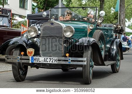Welfenallee, Berlin, Germany - June 16, 2018: A Green Ford Cabrio At The Annual Oldtimer Car Meeting