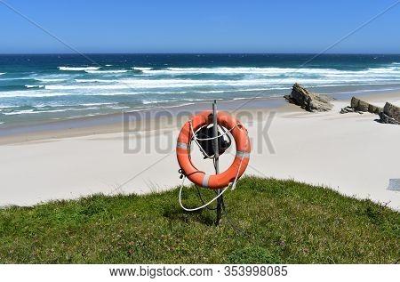 Beach With Life Saver, White Sand And Wild Sea With Waves On A Sunny Day. Viveiro, Lugo, Galicia, Sp