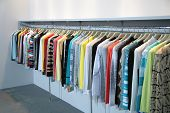 clothes on racks on new modern store poster