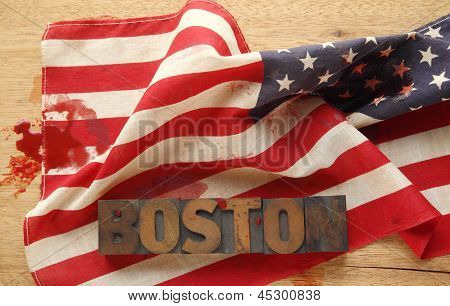 American flag, bloodstains and Boston word in old wood type