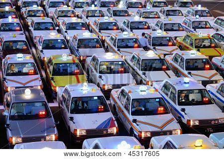 SENDAI, JAPAN - OCTOBER 29: Rows of Taxis October 29, 2012 in Sendai, JP. Japanese taxi fares are considered the highest in the world.