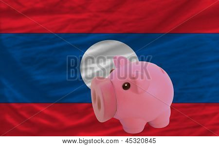 Piggy Rich Bank And  National Flag Of Laos