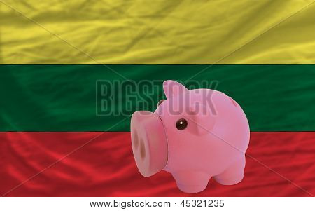 Piggy Rich Bank And  National Flag Of Lithuania