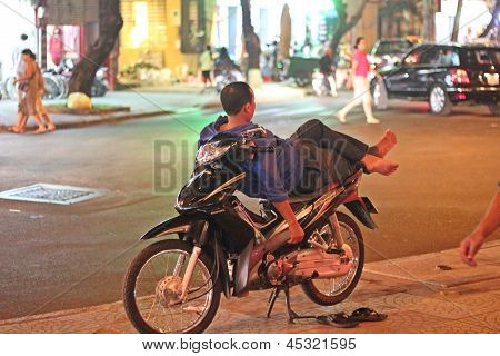 Motorist Relaxing In Hanoi, Vietnam