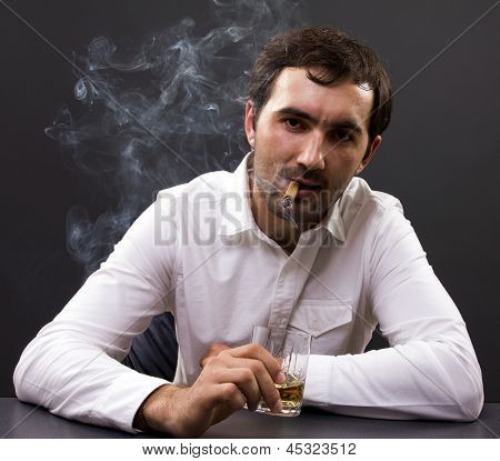 Young Businessman Smoking In His Office