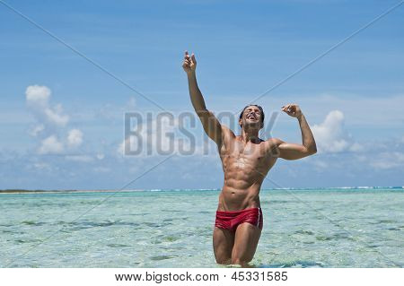 Man enjoying in water on the beach