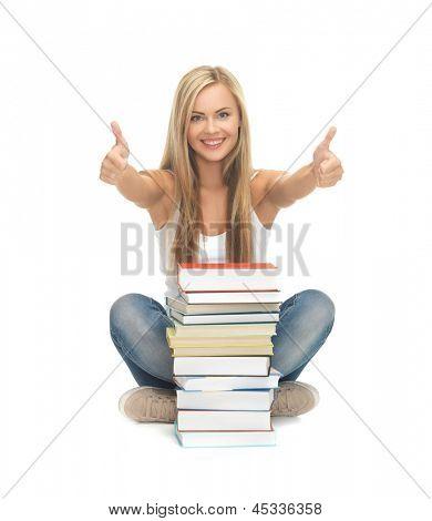 Bild von lächelnd Student mit Stapel von Büchern