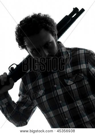 one man serial killer shotgun  silhouette studio isolated on white background