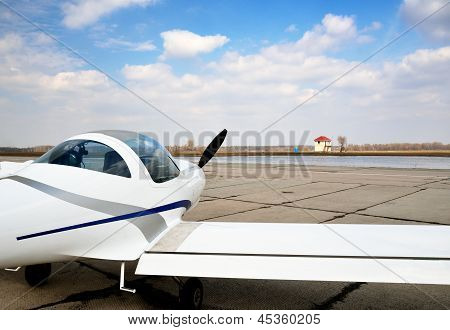 A Modern Light Aircraft On The Airfield