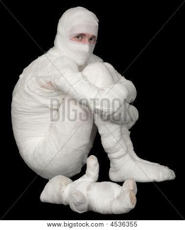 Egyptian Mummy Emo Sitting On A Black