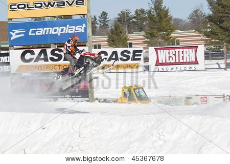 Polaris Red & Black Snowmobile Soaring On Jump