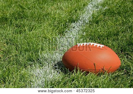 American Football On Natural Grass Field