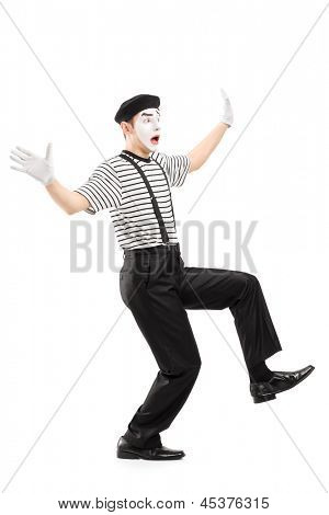 Full length portrait of a surpised mime artist gesturing with hands, isolated on white background