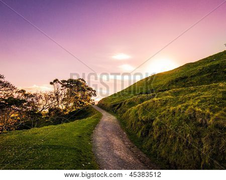 Sunset behind the mountain path