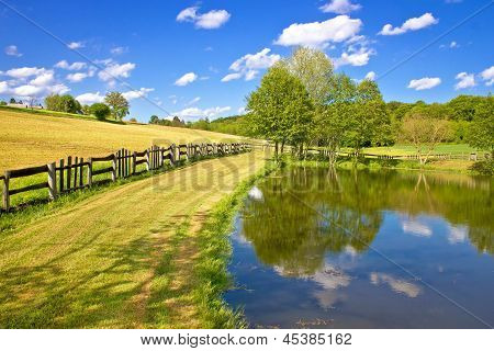 Green lake and fields  landscape