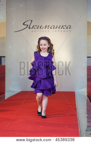 MOSCOW - MAR 18: The girl on the runway at a fashion show in a childrens store Jakimanka on March 18, 2012 in Moscow, Russia.