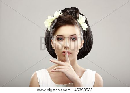 Hush! Beautiful Young Woman Showing Silence Sign With Her Forefinger. Warning