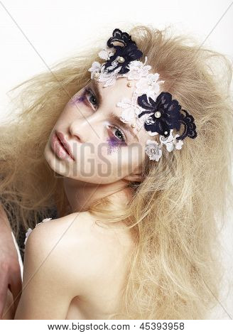 Emotional Caucasian Female With Bright Futuristic Mask And Make-up. Creative Faceart