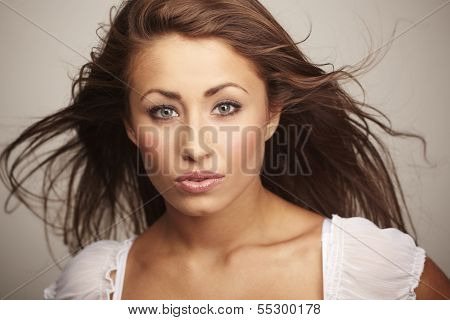 Attractive Young Woman Relaxing On White Background