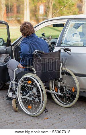 Disabled Driver Next His Car