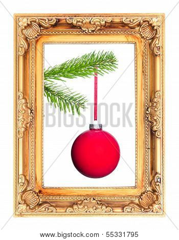 Red Christmas Tree Ball At A Fir Branch In A Picture Frame