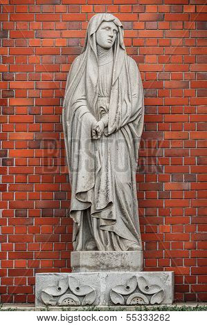Virgin Mary's statue that survived however left the mark of the explosion that the fingers were chopped off by the A-Bomb. poster
