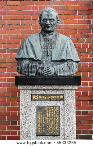 The statue of Pope John Paul II who visited the Cathedral and held a mass in 1981 poster