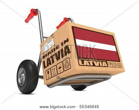 Made in Latvia - Cardboard Box on Hand Truck.