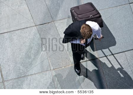 Corporate Man With Luggage And Costume Jacket