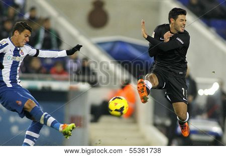 BARCELONA - NOV, 30: Hector Moreno(L) of Espanyol vies with Carlos Vela(R) of Real Sociedad during a Spanish League match at the Estadi Cornella on November 30, 2013 in Barcelona, Spain