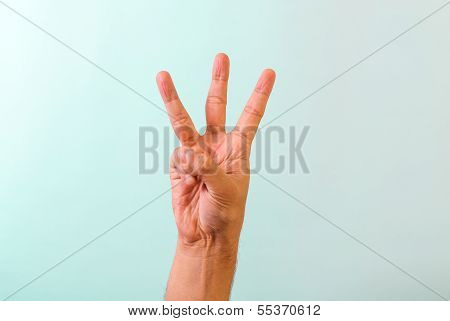 Hand number three concept on blue background