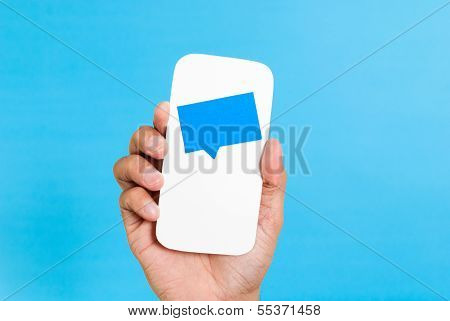 Smartphone Chat Notifications Concept, Hand showing a notification on a cell phone concept