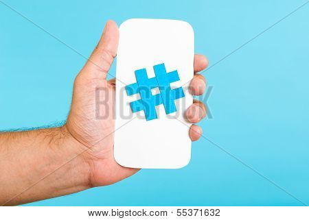 Mobile Hashtag Vertical Concept, Hand showing a sign on white paper with cell phone shape