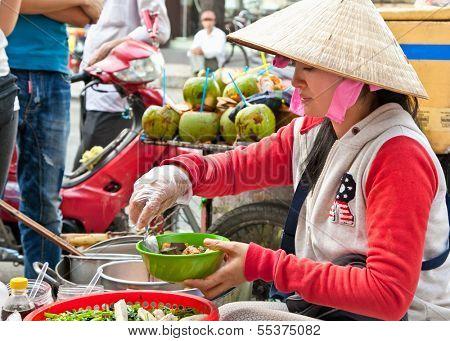 HO CHI MINH, VIETNAM-NOVEMBER 17. 2013: Street food vendor in the street of Ho Chi Minh on Noveber 17, 2013, Vietnam. Estimate 10.6% of Vietnam's population is below the poverty line.