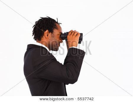 Sidewise closeup of afro-american businessman with binoculars poster