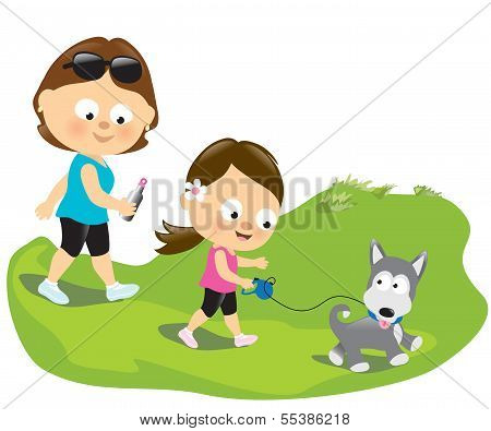 Mother and daughter walking the puppy
