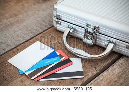 Steel Case And Credit Cards On Wooden Floor